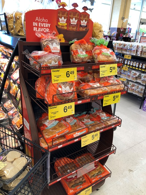 King's Hawaiian product display - dinner rolls, bread, hamburger buns, and hot dog rolls.